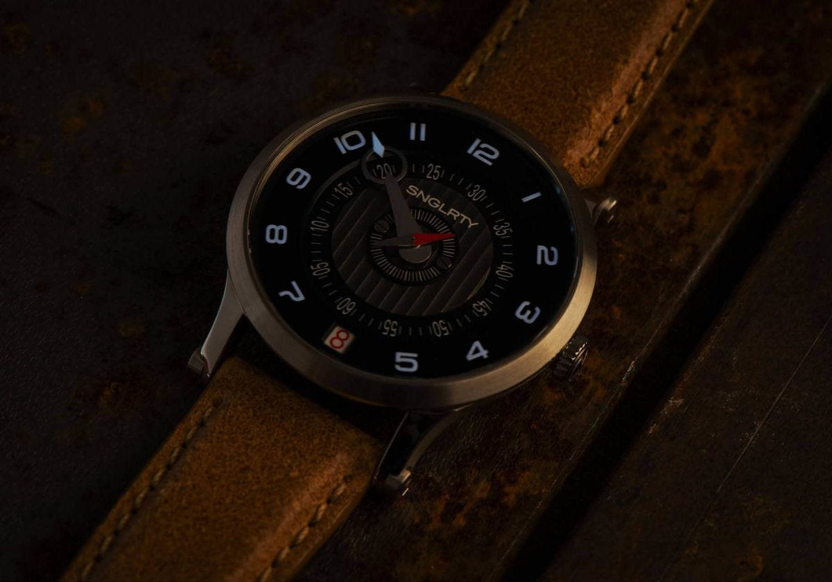 SNGLRTY WATCH in the dark showing super luminova