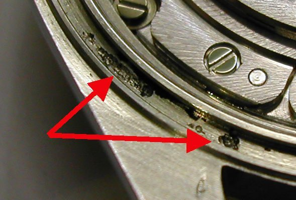 corrosion pitting on a stainless steel watch case around the O-ring gasket