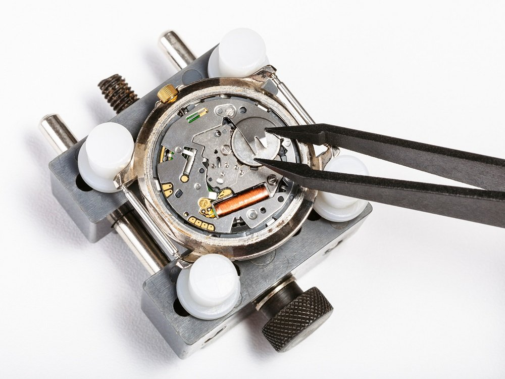 view of the back of a quartz watch movement