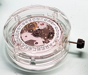 watch movement in its transport case from the manufacturer